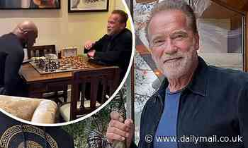 Arnold Schwarzenegger invites Mike Tyson over to his LA mansion for chess match and golfing - Daily Mail