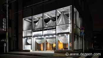 Theatrical curtains enclose the entrance of Tokyo fashion store The Playhouse - Dezeen