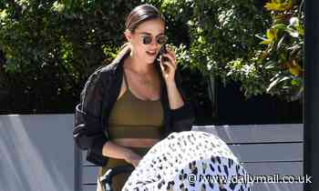 Monika Radulovic shows off her trim post-baby body as she runs errands with son Luka in Sydney