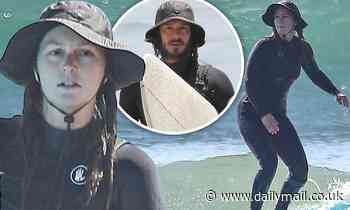 Leighton Meester shows off newfound surfing skills in Malibu alongside husband Adam Brody