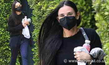 Demi Moore exudes effortless elegance as she rocks all black while leaving Pilates class