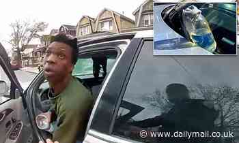 Shocking moment motorist throws a chemical on NYPD officer during a routine 8am traffic stop
