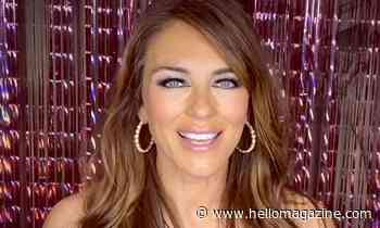 Elizabeth Hurley dazzles in satin gown with thigh-high slit in rare picture inside family home
