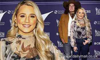 Gabby Barrett rocks patterned blouse and jeans as she arrives to the ACM Awards