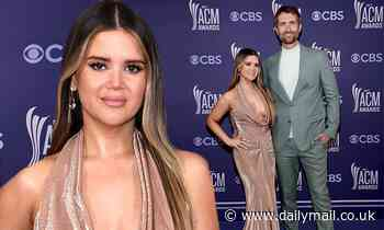 Maren Morris flashes cleavage in jaw-dropping gown on ACM Awards red carpet with hubby Ryan Hurd