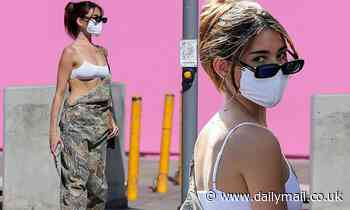 Madison Beer bares her white bra beneath baggy camouflage overalls in West Hollywood