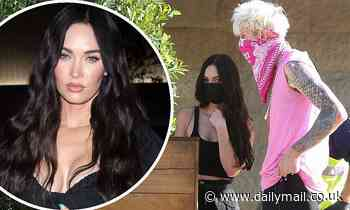 Megan Fox shows off cleavage during solo outing... before enjoying lunch date with Machine Gun Kelly