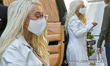 Christina Aguilera is unmissable in full-length white coat and bleach blonde hair in Beverly Hills - Daily Mail