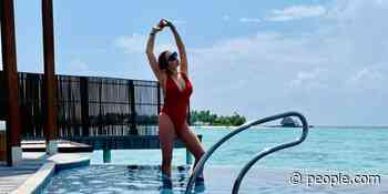 Lindsay Lohan Shows Off Her Curves in a Plunging Red Swimsuit in the Maldives - PEOPLE