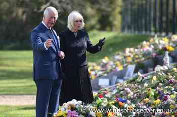 Charles and Camilla view flowers left in memory of Philip - Windsor Observer