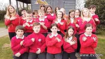 Schoolchildren sign Robbie Williams song for Autism Awareness Month - ITV News