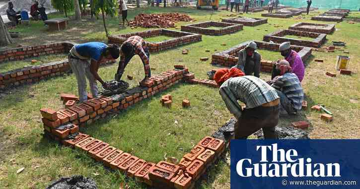 Crematoriums in Delhi forced to build makeshift pyres as India's Covid crisis intensifies – video