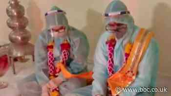 Covid in India: Couple marry in PPE clothing