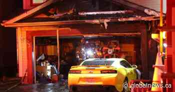 Early morning fire guts garage of McKenzie Lake home