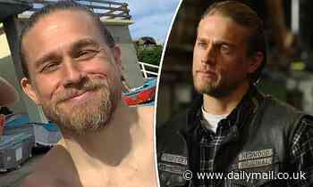 Sons of Anarchy star Charlie Hunnam smiles for a selfie with a fan in Sydney - Daily Mail
