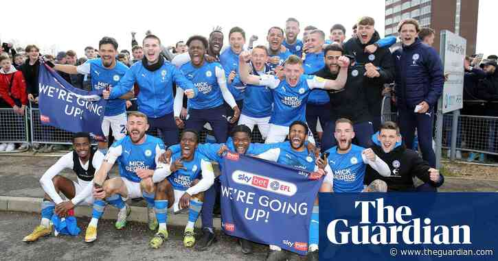 Football League roundup: Peterborough promoted after three-goal comeback