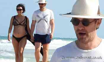 Glee's Matthew Morrison takes a romantic beach stroll with pregnant bikini-clad wifeRenee in Mexico