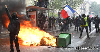 France: Scuffles and arrests in Paris as thousands mark May Day - Al Jazeera English