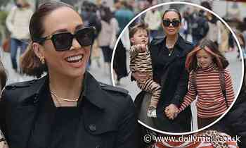 Myleene Klass cuts a stylish figure in black coat as she steps out with daughter Hero and son Apollo