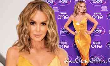 Amanda Holden puts on a glamorous display in plunging gold gown