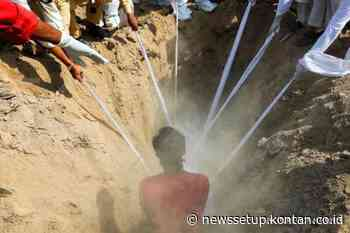 Penggali kubur di Mumbai bekerja shift 24 jam, tak pernah libur setahun terakhir - Kontan