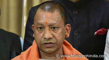 Adityanath hides spiralling Covid deaths by covering up crematories and banning pictures - Telegraph India