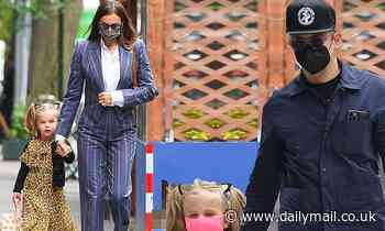 Bradley Cooper and Irina Shayk both seen out with their daughter Lea who is in leopard print