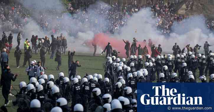 Riot police break up illegal party in Brussels park using tear gas and water cannon – video