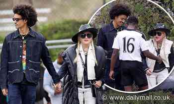 Madonna the soccer mom (with 27-year-old toyboy): Singer, 62, cheers on son David with younger lover