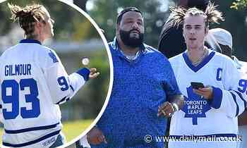 Justin Bieber dons a Happy Gilmore jersey as hits the links for a wacky game of golf with DJ Khaled