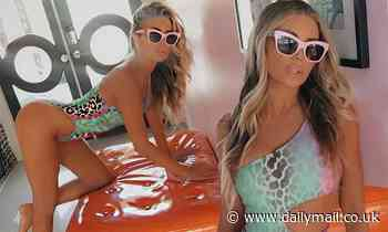 Carmen Electra proves that she still looks amazing in a swimsuit as she poses for Instagram snaps