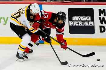 Bergeron, Bruins blank Devils to clinch playoff spot