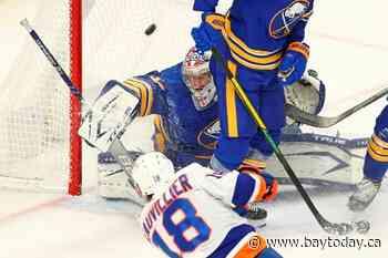 Houser wins in NHL debut as Sabres rallly past Islanders 4-2