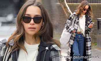 Emilia Clarke cuts a casual figure in a chic checked trench coat as she heads to buy groceries - Daily Mail