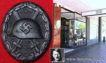 Outrage as Sydney antique store sells NAZI memorabilia including swastika medals and Hitler photos