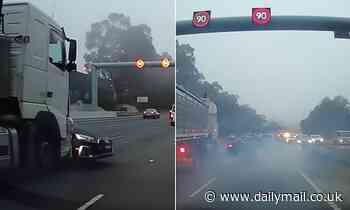 Shocking footage captures the moment a truck takes out an Audi on Sydney highway