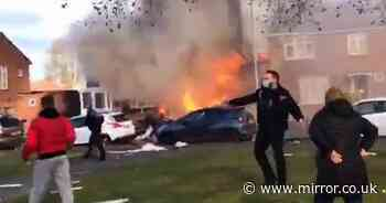 House 'explodes' and erupts in flames as crews rescue trapped residents
