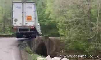 Tennessee trucker narrowly avoids crashing off a narrow bridge