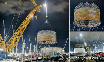 Big Carl takes the strain: World's largest crane lifts steel ring into place at Hinkley Point C