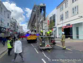 Western Road: Fire fighters and police cordon on busy street