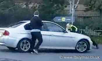 Leeds security guard clings to the bonnet of a car trying to escape retail park