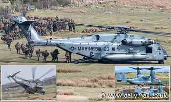 US Marines pile aboard twin-propeller Osprey and Sea Stallion choppers