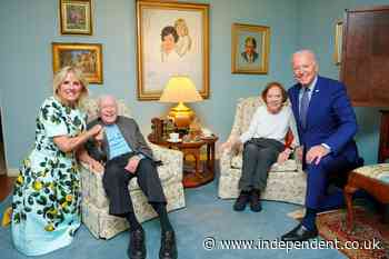 Smiling Jimmy Carter seen in photo from Biden visit