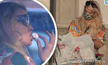 Jessica Simpson EXCLUSIVE: The star is seen munching on a donut