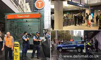 Sydney's Town Hall station is evacuated with all trains stopped and police searching the area