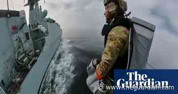 Royal Marines test jet suit between moving ships – video