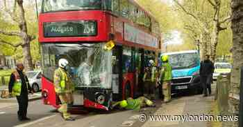 Hackney bus crash sees woman in hospital and man trapped in double-decker - My London