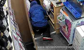 Hooded man threatened Bargain Booze shopworkers with screwdriver