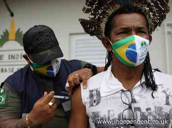 Bows and arrows greet healthcare workers delivering Covid vaccine in Amazon