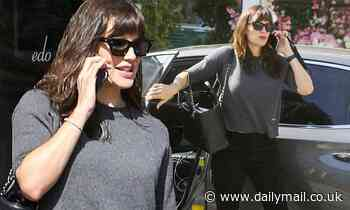Jennifer Garner keeps it casual in sweater and jeans as she chats on phone during LA coffee run